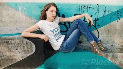 White Girl Sitting Down on a Skating Park Wearing a T-Shirt Cinemagraph a13536