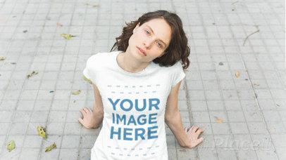 Pretty Girl Sitting on a Windy Peatonal Wearing a T-Shirt Stop Motion a13538