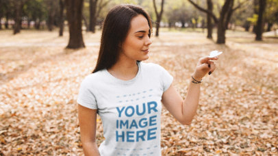 Girl at a Park Wearing a T-Shirt Stop Motion With a Paper Butterfly a13519