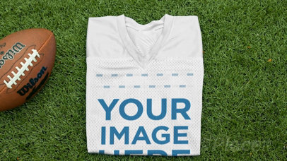 Custom Football Jerseys - Folded Jersey Near a Football at the Field a16935