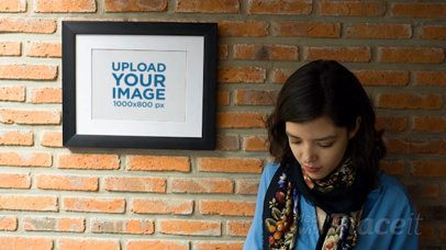 Girl Texting on her Phone While Against a Bricks Wall With a Framed Art Print Video a14355