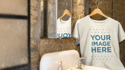 T-Shirt Video Mockup in a Hanger Inside a Vintage Bathroom a13138