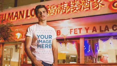 Young Hipster Man Wearing a Short Sleeved Tee Cinemagraph Outside a Chinese Restaurant a13530