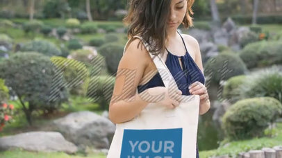 Amazing Mockup Video Of Pretty Young Woman Carrying A Tote Bag While At The Park a13878b