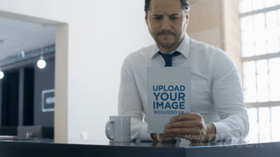 Business Man Having a Coffee While Taking a Look at a Book Video Mockup a14152