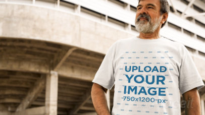 Man with a Beard Wearing a Round Neck Tee Video Outside a Stadium a12764