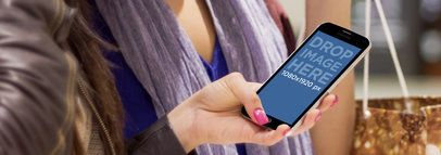 Samsung Galaxy S5 Mockup of Two Women at a Mall Wide