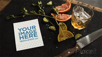 Flyer Lying on a Table With Knife and Lemon While Glass Ice is Moving in Stop Motion a13723