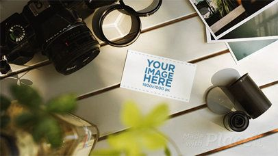 Stop Motion of a Business Card Lying on a Photographers White Table While Things Are Moving a13870