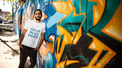 Hipster Guy with a Man Bun Leaning Against a Graffiti Wall Wearing a T-Shirt Stop Motion a13214