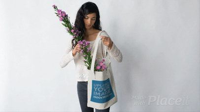 Pretty Girl Putting Flowers in her Tote Bag Against a White Background in Stop Motion a13669
