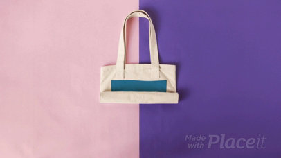 Tote Bag in Stop Motion Rolling Over a Pink and Purple Background a13667