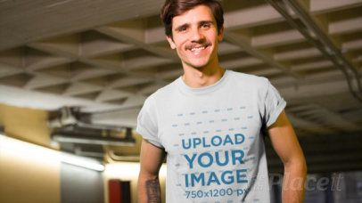 Hipster Guy with Tattoos and a Mustache Walking Through a City Tunnel Wearing a T-Shirt Video a13466