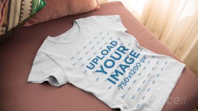 Video Closeup of a Round Neck T-Shirt Spread Over a Sofa a13088