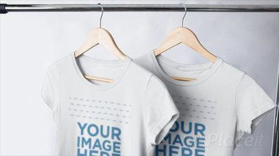 Video of Round Neck T-Shirts Hanging on a Clothing Rack a13147