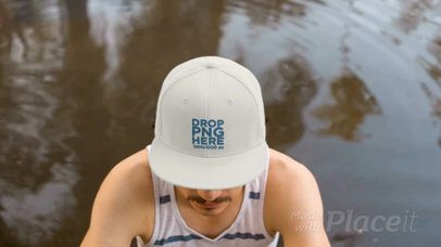 Young White Man Wearing a Hat Video While at a Lake a14162