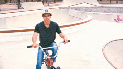 Young Hispanic Man Riding a Bike in a Skatepark Wearing a Snapback Hat Video a14189
