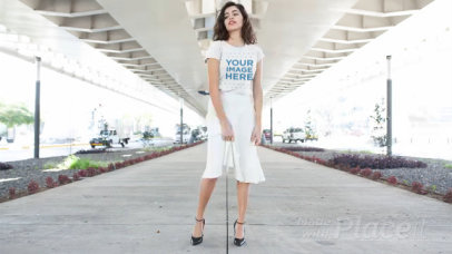 Young Woman Wearing a Long Skirt and a T-Shirt Stop Motion in an Urban Environment a13599