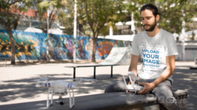 Hipster Wearing a Tshirt While Playing With Remote Control Helicopter Cinemagraph a13368