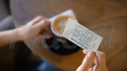 Person Having a Cappuccino at a Cafe Holding a Business Card Video a13943