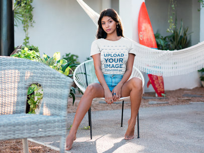 Latin Woman Wearing a Tshirt Mockup Sitting on an Acapulco Chair a18802