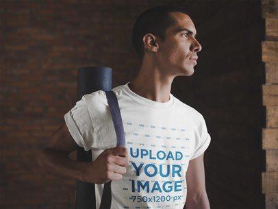 Mockup of a Man Wearing a T-Shirt Mockup Carrying a Yoga Mat a19967