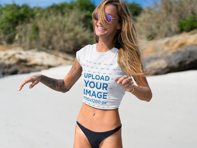 Happy Blonde Girl Laughing Wearing a Tshirt Mockup at the Beach a18822