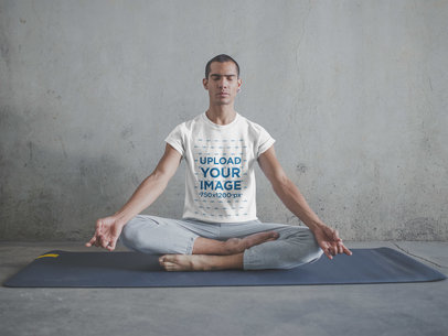 Man Wearing a T-Shirt Mockup Meditating in Lotus Position a19960