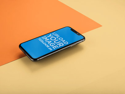 iPhone X Mockup Floating Over Two Pasteboards a20013