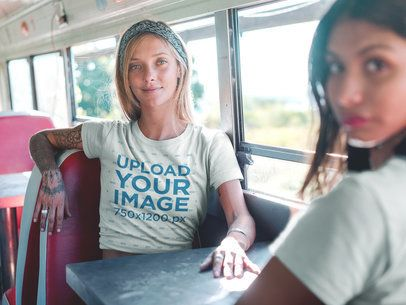 Blonde Woman Wearing a Tshirt Template on a Vintage Bus with a Friend a18843