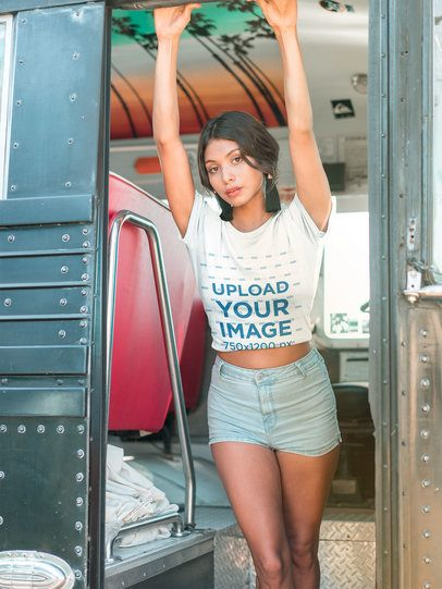 Latina Girl Wearing a Tshirt Mockup Holding to a Bus Door a18841