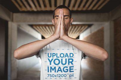 Man Focusing Wearing a T-Shirt Mockup at a Yoga Session a20032