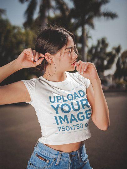 Asian Woman Wearing a Crop Top T-Shirt Mockup Under the Sun a19292