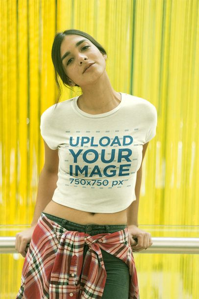 Happy Girl Wearing a Crop Top Tee Mockup Against a Greenish Yellow Curtain a19532