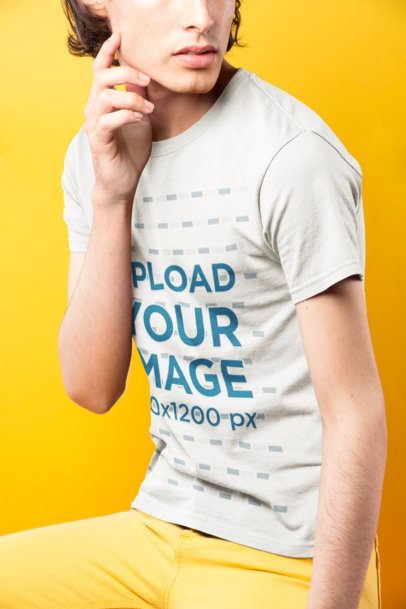 Cropped Face Dude Wearing a T-Shirt Mockup Against a Yellow Background a19674