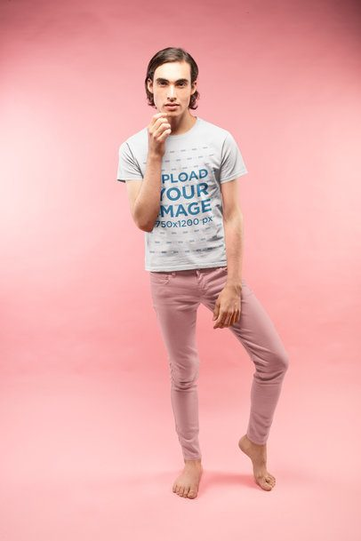 Man Posing Wearing a Tshirt Mockup in a Pink Room a19672