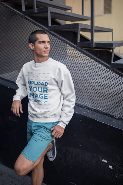Man Leaning Against Stairways Wearing a Sweatshirt Mockup a19707