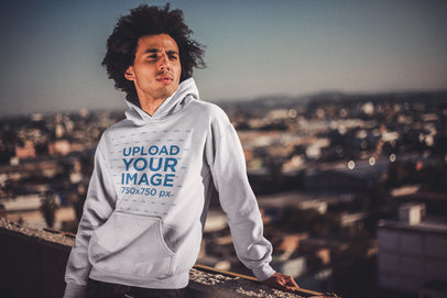 Man with Afro Wearing a Pullover Hoodie Mockup in the City a18949
