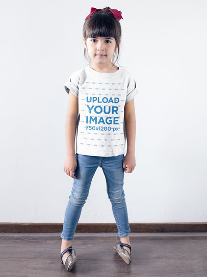 Little Girl Wearing a T-Shirt Mockup Against a White Wall a19465