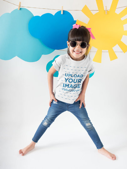 Happy Girl Wearing a T-Shirt Mockup and Round Sunglasses Under Sky Decorations a19478