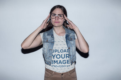 Nerd Girl with Glasses Wearing a T-Shirt Mockup and a Denim Vest a19262
