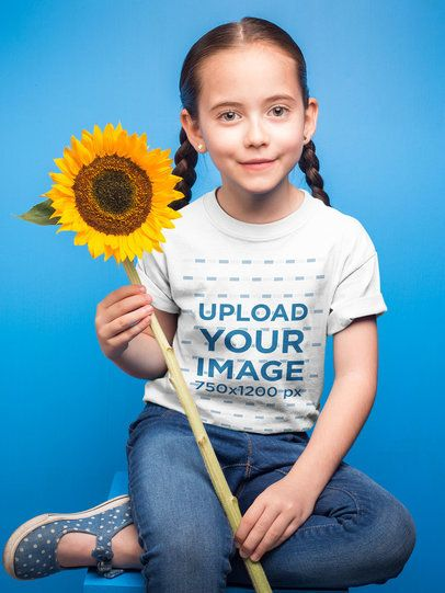 Little Girl with Braids Wearing a T-Shirt Mockup Holding a Sunflower a19732