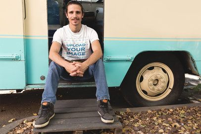 Man Sitting on his Foodtruck Door Wearing a T-Shirt Mockup a20304