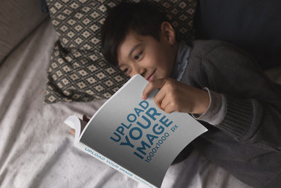 Happy Kid Reading a Book Mockup While in Bed a19165