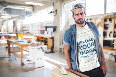 Bearded Carpenter Wearing a T-Shirt Mockup at the Shop a20161