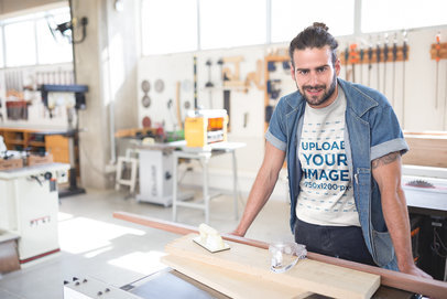 Long Haired Bearded Carpenter Wearing a T-Shirt Mockup at the Shop a20164
