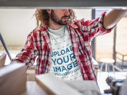 Long-Haired Carpenter Wearing a T-Shirt Mockup at the Shop a20172