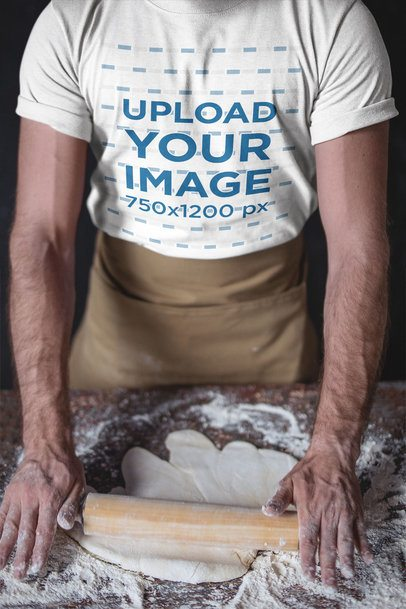 Closeup of a Baker Wearing a T-Shirt Mockup Kneading the Dough with a Rolling Pin a20266