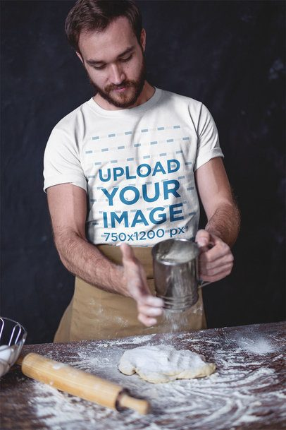 Baker Wearing a T-Shirt Mockup while Using a Flour Sifter a20268