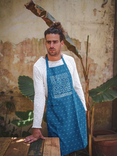 Man Wearing an Apron Template Leaning Against a Table Near a Plant a19881